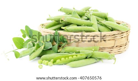 Fresh green peas in basket on a white background. - stock photo