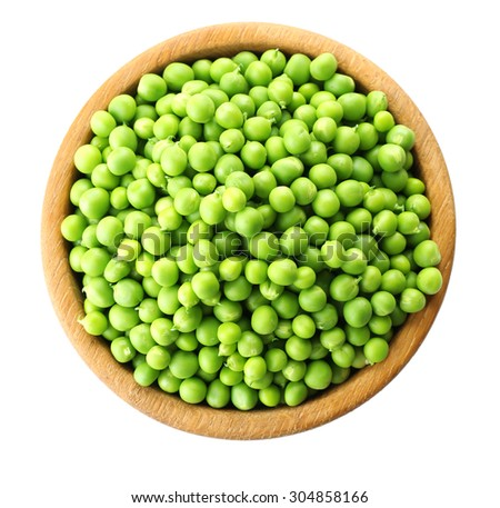 Fresh green peas in bowl isolated on white - stock photo
