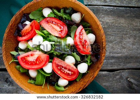 fresh green salad mix in a wooden bowl - stock photo