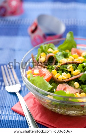 Fresh green salad with corn and anchovy