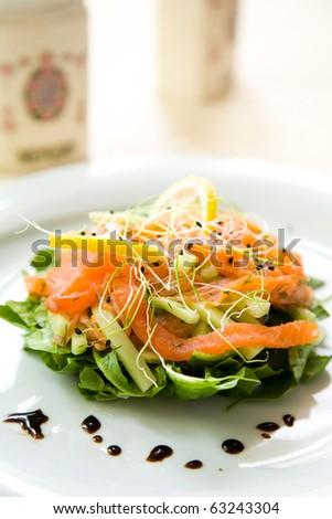 Fresh green salad with smoked salmon,avocado and lemon - stock photo