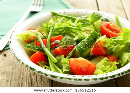 fresh green salad with tomatoes and asparagus - stock photo