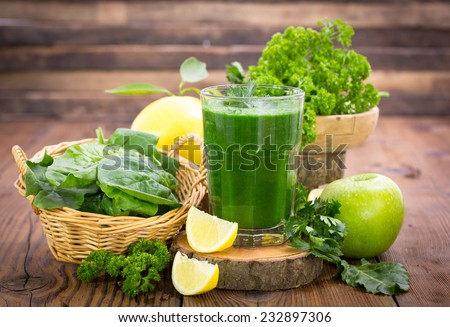 Fresh green smoothie in the glass - stock photo