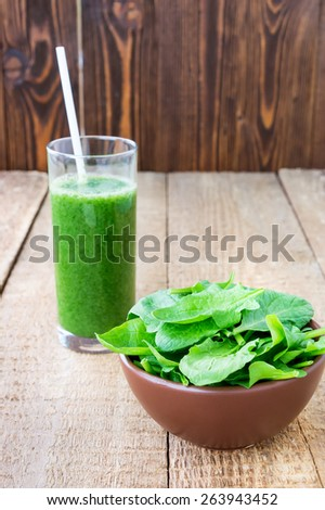 Fresh green smoothie with spinach on wooden background - stock photo