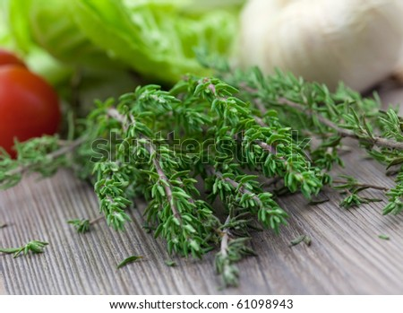 fresh green thyme on board - stock photo