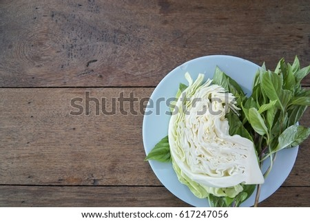 Fresh green vegetable on wood table background - healthy or vegetarian food concept Top view.