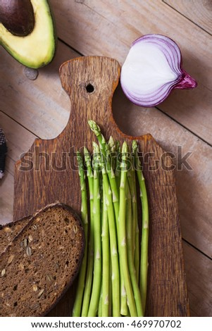 Fresh green vegetables and red onion