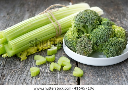 Fresh green vegetables. Celery and broccoli - stock photo