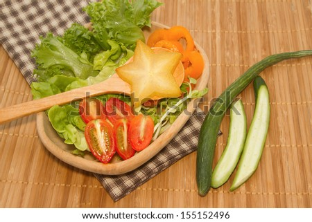 fresh green vegetables  salad with star fruit - stock photo