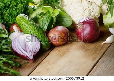 Fresh green vegetables set on the wooden table