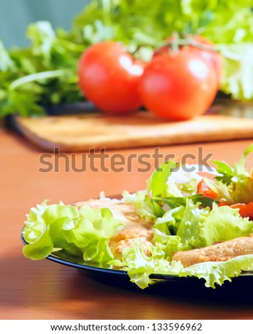 fresh greens for salad preparation. tomatoes, onions, salad, red pepper, parsley - stock photo