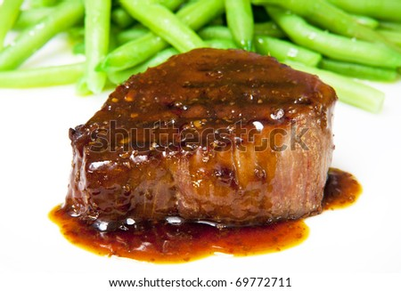 Fresh grilled beef steak on white plate close up