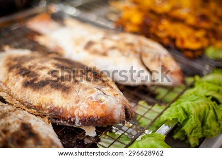 Fresh grilled whole red snapper fish in sea salt. Traditional thai cuisine. - stock photo