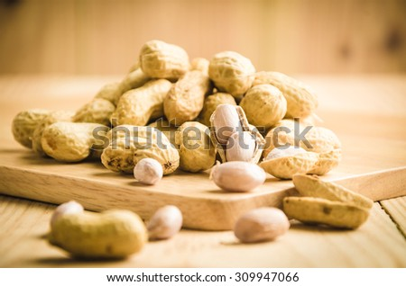 fresh ground nuts on wooden  background - stock photo