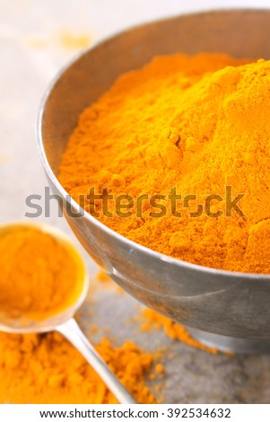 fresh ground turmeric spice  in dish