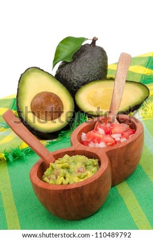 Fresh Guacamole and Pico de Gallo with Avocados in background - stock photo