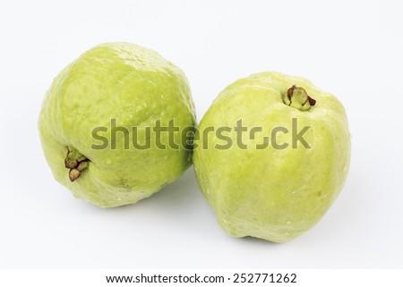 Fresh guava fruit on white background - stock photo