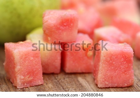Fresh guava on wooden surface - stock photo