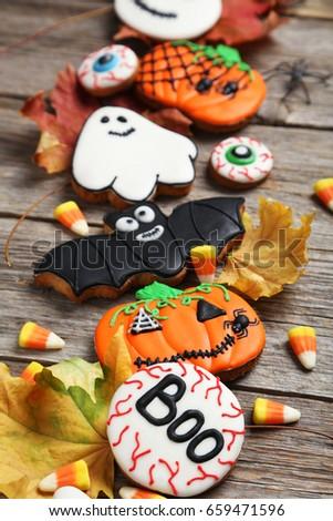 fresh halloween gingerbread cookies on grey wooden table - Halloween Gingerbread Cookies