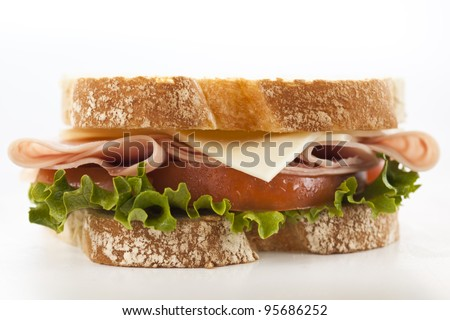 fresh ham cheese tomato and lettuce sandwich - stock photo