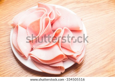 Fresh ham slices with  on the plate - stock photo