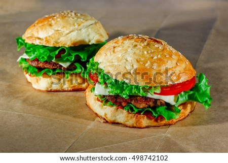 Fresh hamburgers on craft paper