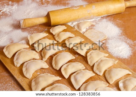 Fresh hand made dumplings ready to cooking - stock photo