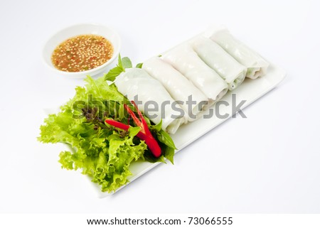 Fresh Handmade Vegetable Spring Rolls On White Surface - stock photo