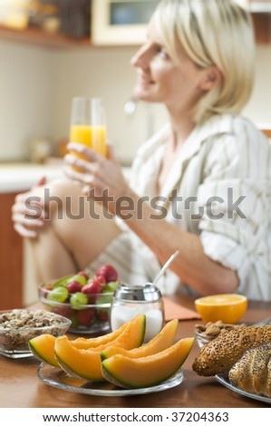 Fresh healthy breakfast with young girl in background