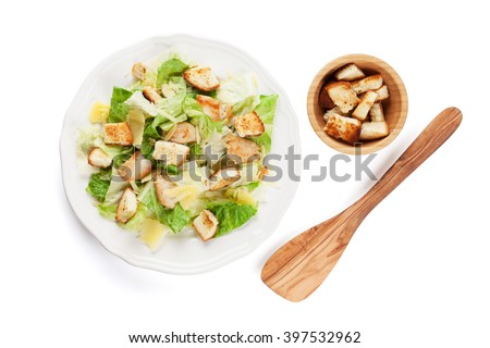 Fresh healthy caesar salad. Isolated on white background. Top view - stock photo