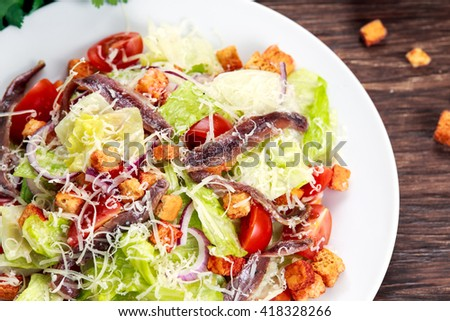 Fresh healthy Classic Caesar salad with anchovies. - stock photo