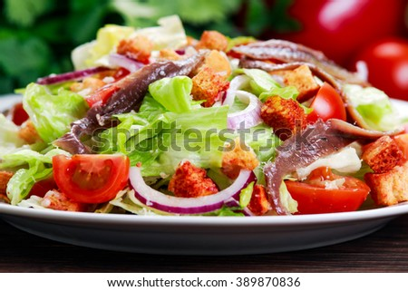 Fresh healthy Classic Caesar salad with anchovies. selected focus. - stock photo