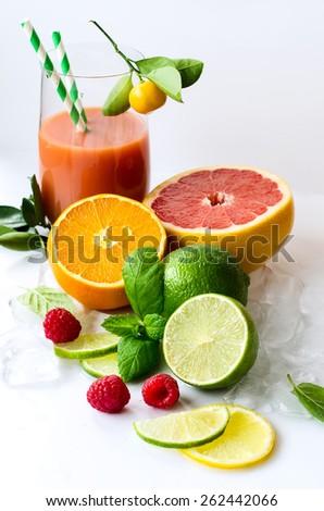 Fresh healthy detox citrus smoothie with grapefruit, orange, raspberries - stock photo