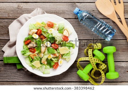 Fresh healthy diet salad on wooden table. Top view - stock photo
