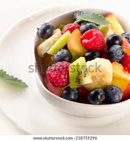 Fresh healthy fruit salad in a white bowl. Selective focus
