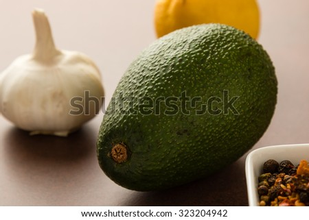 fresh healthy green avocado fruit with lemon, onion and condiments