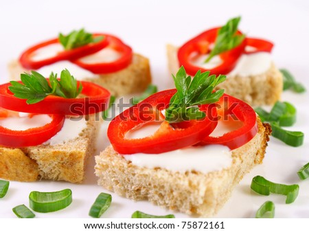 Fresh healthy mini sandwiches with pepperoni and onion - stock photo