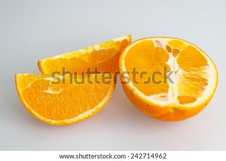 fresh healthy orange in half or slices - stock photo
