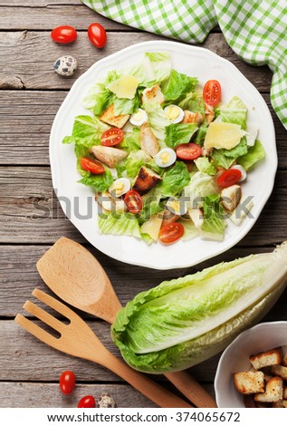 Fresh healthy salad on wooden table. Top view - stock photo