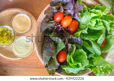 Fresh healthy salad on wooden table. Top view