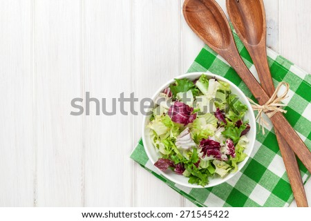 Fresh healthy salad over white wooden table. View from above with copy space   - stock photo
