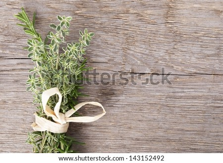 fresh herbs for cooking or fragrance on a wooden background - stock photo