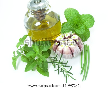 Fresh herbs, garlic and olive oil. - stock photo