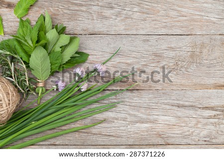 Fresh herbs on garden table. Top view with copy space - stock photo