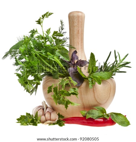 fresh herbs with spices in a mortar  isolated on white - stock photo