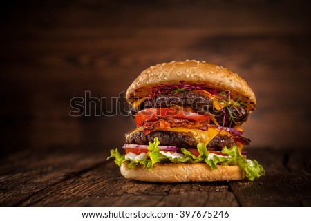 Fresh home-made hamburger served on wood