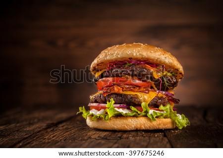 Fresh home-made hamburger served on wood - stock photo