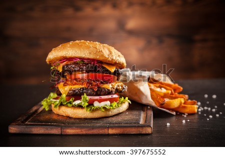 Fresh home-made hamburger served on wood - stock photo