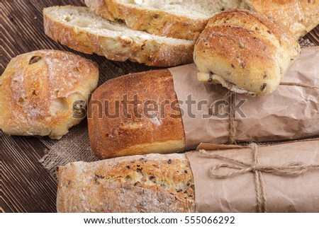 Fresh homemade bread placed on a wooden table