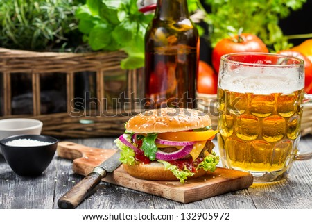 Fresh homemade burger and a cold beer